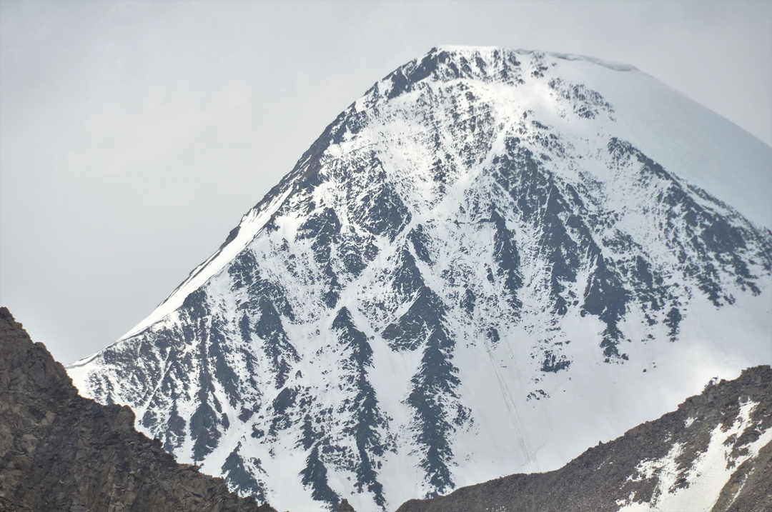 A long shot of Rangston Gyathok from the Phurdokpa Glacier to the south. The route of ascent is initially on the left skyline and then behind it.