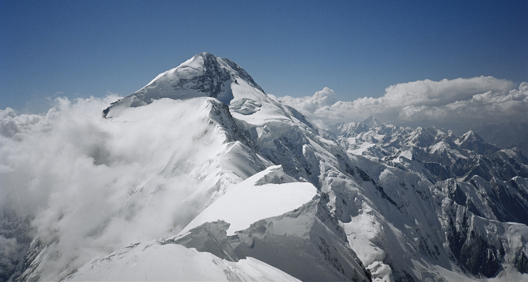 The main summit of Pik Pobeda (7,439m) seen along the frontier ridge from Pobeda East.