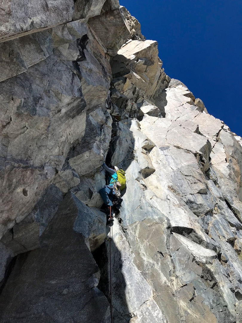 Derek Field leads the steep opening pitch (5.10a) on the east ridge of Bedayan Minaret.