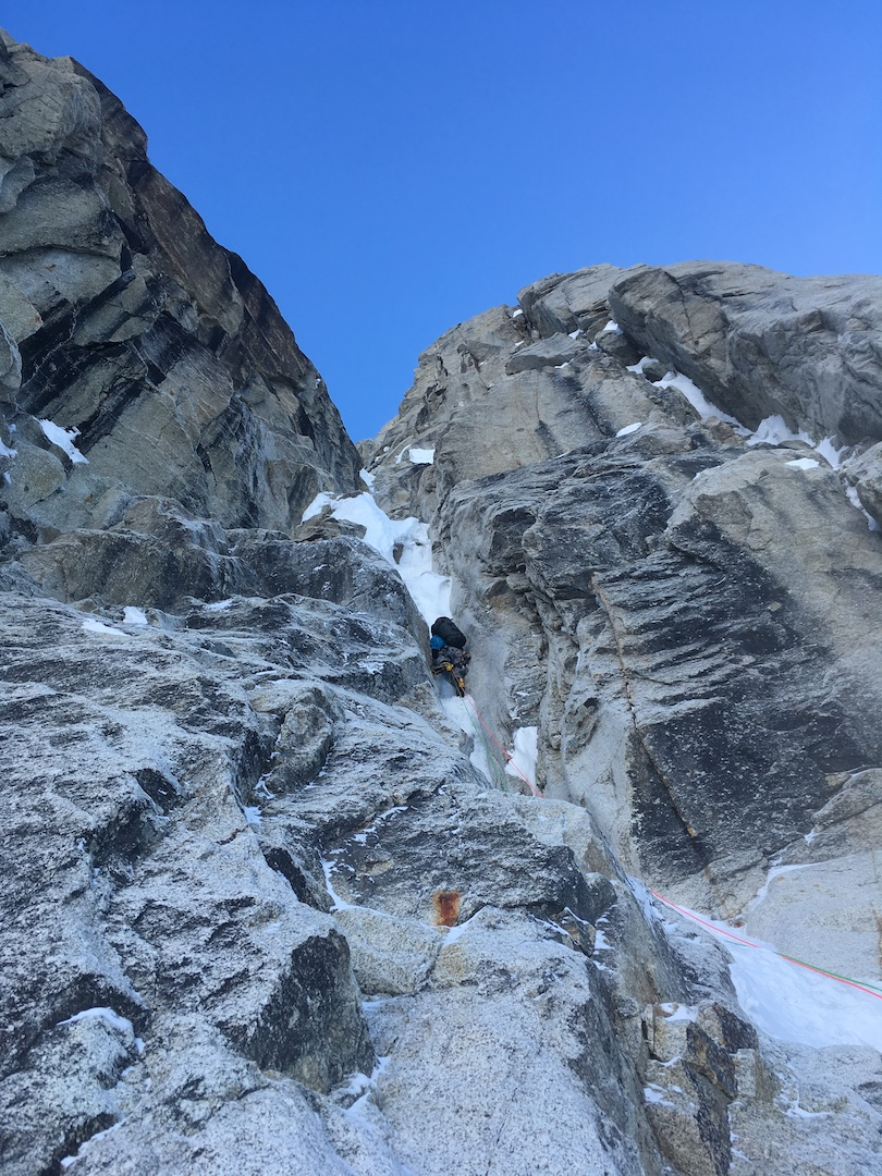 Steven Van Sickle leading up the lower wall on West Kahiltna Peak's southwest face on the first attempt of what would become Ride the Bullet (4,000', AI5+ R M6+ C1). Soon after, Sickle later took a bad leader fall and had to be rescued off the face.