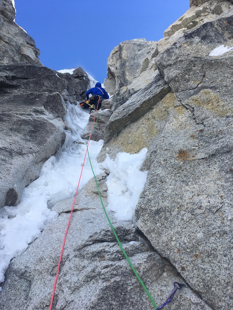 Kurt Ross climbing into one of the many chimney pitches on Ride the Bullet (4,000', AI5+ R M6+ C1) on West Kahiltna Peak.