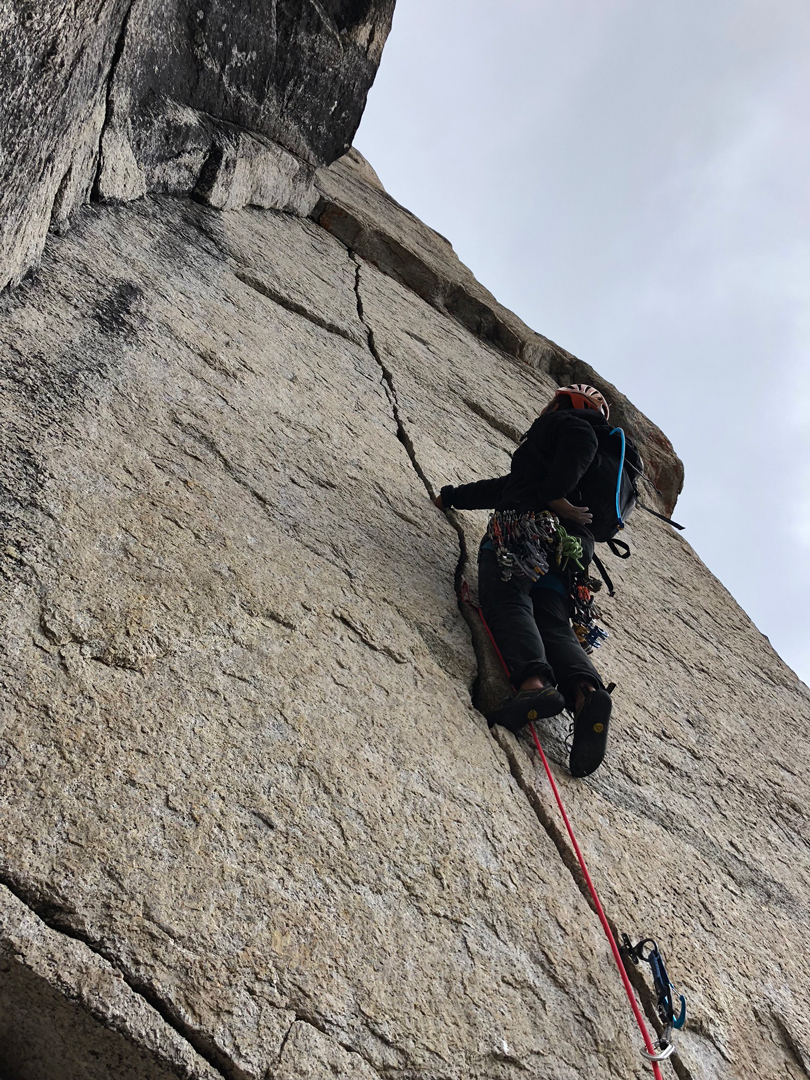 Justin Loyka heading up the beautiful thin-hands splitter on the fourth pitch of Noble Beast (1,300', 5.11 C1) on Cathedral Peak in the Wind River Range.