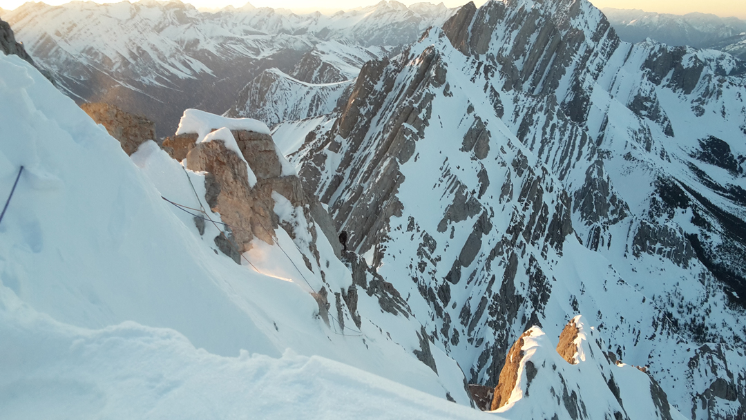 Brette Harrington descending the northwest ridge shortly before dark, after she and Rose Pearson completed Life Compass (980m, TD+ 5.10a M4+ 80°) on Mt. Blane. The two eventually decided to rappel to the west.