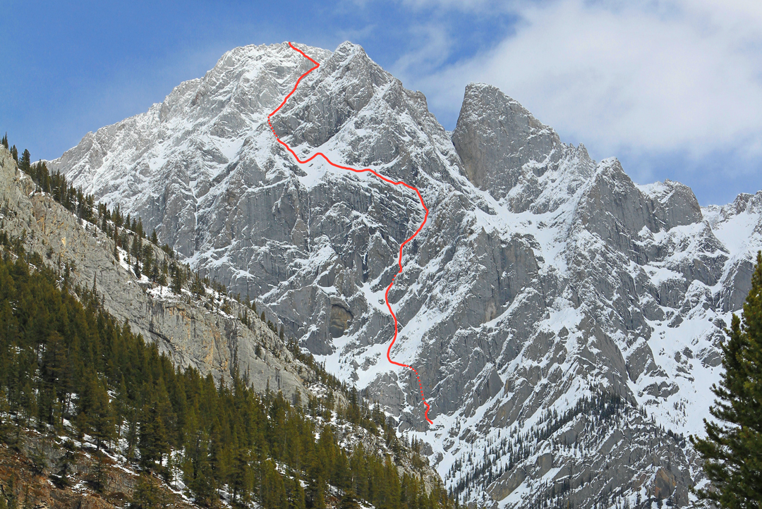 The route line for Rose Pearson and Brette Harrington's Life Compass (980m, TD+ 5.10a M4+ 80°) on the west face of Mt. Blane in the Opal Range. This line is similar to a route climbed in the summer of 1957 by Heinz Kahl and Peter Schotten, with likely a harder start than the 1957 route and an independent finish. Other routes climb the face to the left.