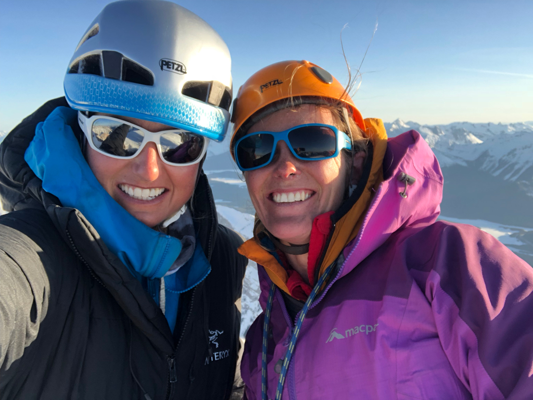 Brette Harrington (left) and Rose Pearson enjoying the evening sun after completing their route Life Compass (980m, 5 TD+ 5.10a M4+ 80°) on Mt. Blane.