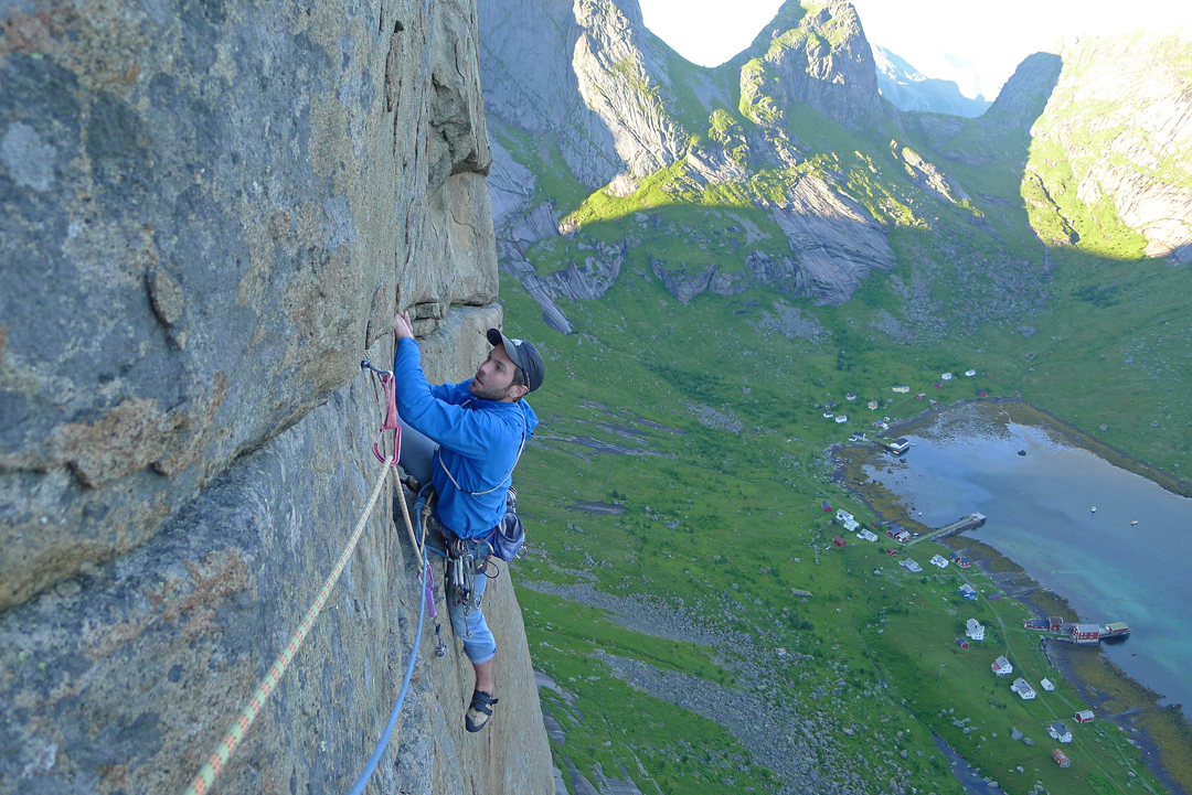 Mike Rolf following the traverse above the steep hand crack on pitch nine (Norwegian 7) of Indiana, Merraflestinden.