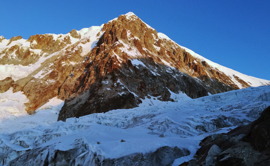 The north (left) and west faces of Illampu, separated by the northwest buttress (facing the camera) in dry conditions similar to those when the Spanish climbed the west face in 1978.