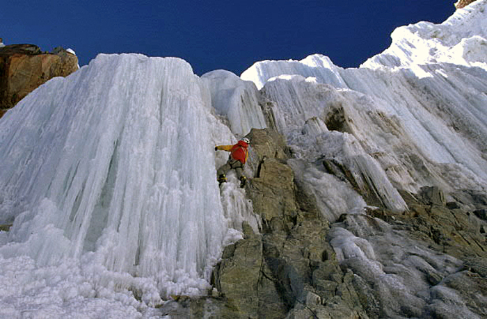 Jérome Mercader about to embark on the icefall (WI5) at the top of the initial gully of Conjuration des Imbeciles, north face of Illampu.