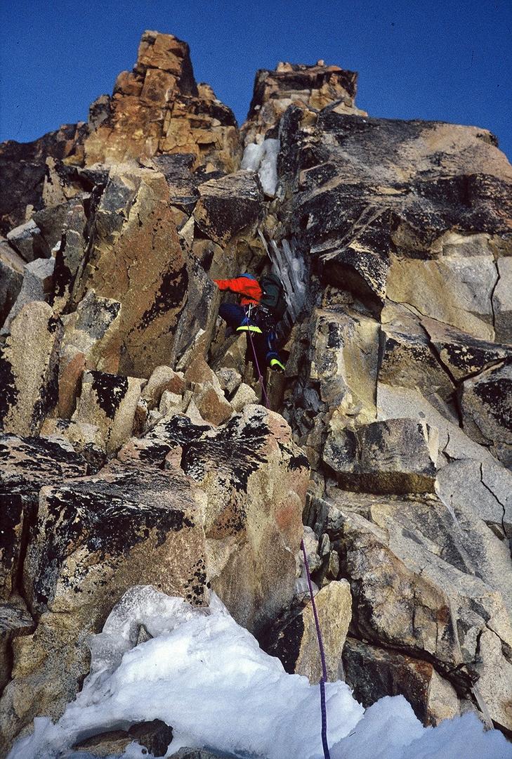 Climbing the rock pillar right of the seracs high on Nada Mañana, west face of Illampu.