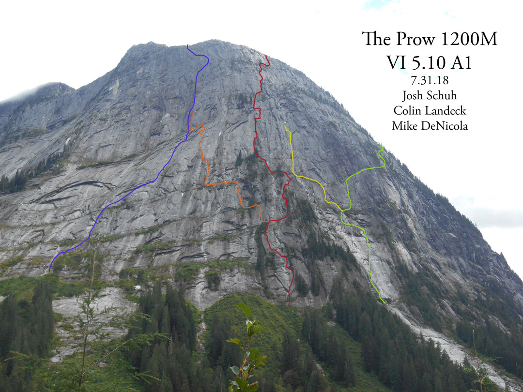 The north side of the Super Unknown formation, showing all known routes and attempts to date. Blue line: Vercoe-McMahon Memorial Route, a.k.a. Dude Wall (1,020m, VI 5.11 A2, Foster-Leiterman-McMahon-Vercoe, 2018). Orange line: Unfinished attempt (Burbach-Merkin, 2018). Red line: The Prow (1,200m, VI 5.10 A1, DeNicola-Landeck-Schuh, 2018). Yellow line: Unfinished attempt (Landeck-Schuh, 2018). Green line: Sacred Stone (1,200m, VI 5.10 A1, Landeck-Guilbault, 2017).