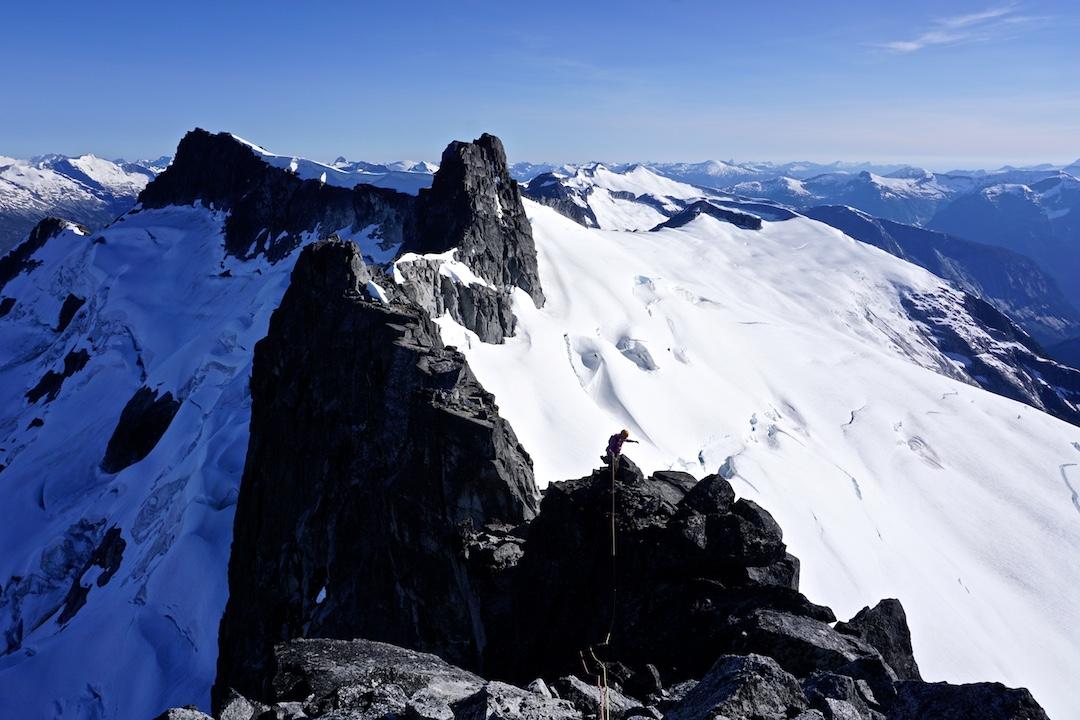 Zoe Manson on the summit ridge of Rogue Tower, looking southwest toward Mt. Denman.