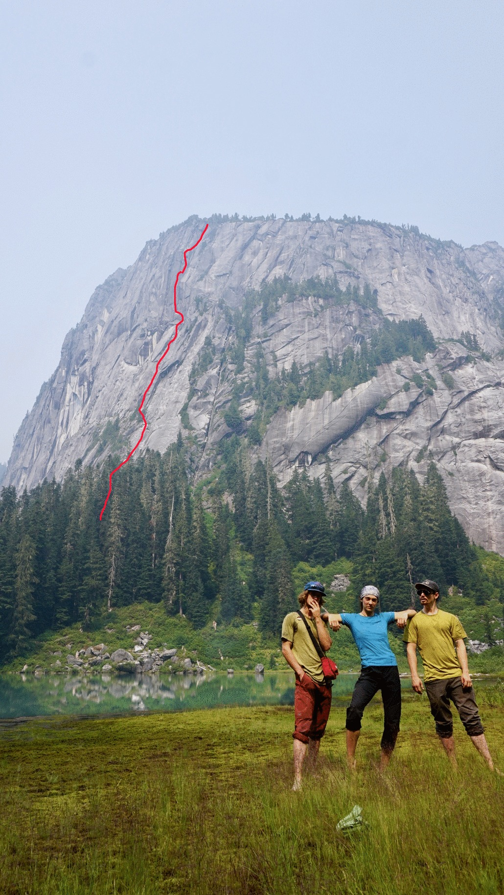 Evan Guilbault, Zoe Manson, and Max Merkin (left to right), with the first ascent of the southwest face of the Lady (550m, V 5.10 C3) shown behind.