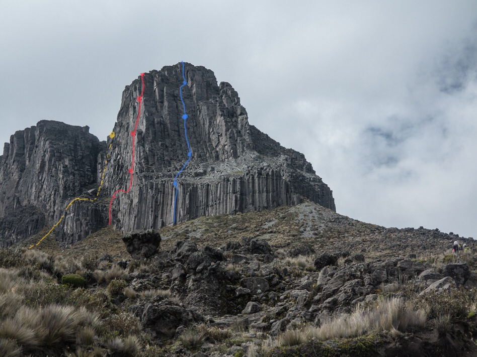 Warmi Torre, showing Strange and Eternal (3 pitches, 5.10) in red and the route Warmi Torre Direct (4 pitches, 5.10+) in blue. The descent line is marked in yellow.