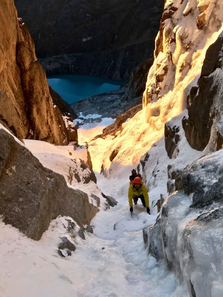 Climbing the initial goulotte on Jurau B as the sun rises.