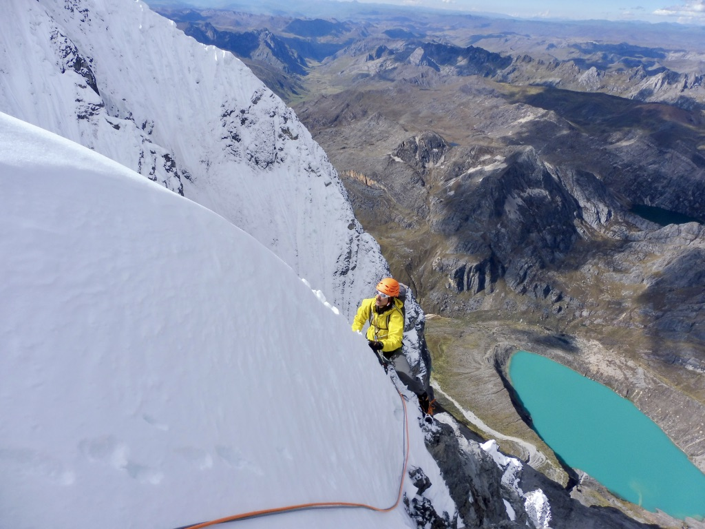 The Peruvian color palette: Climbing along a snow rib on the upper portion of Jurau B, with the turquoise Laguna de Siulácocha and eastern tundra below.