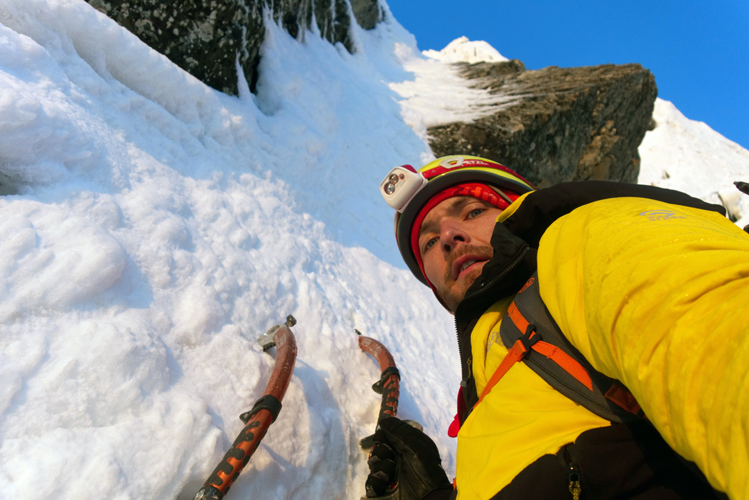 Kirill Belotserkovskiy pauses during his solo ascent of a new route on the left side of the north face of Ordzhonikidze (4,410m).