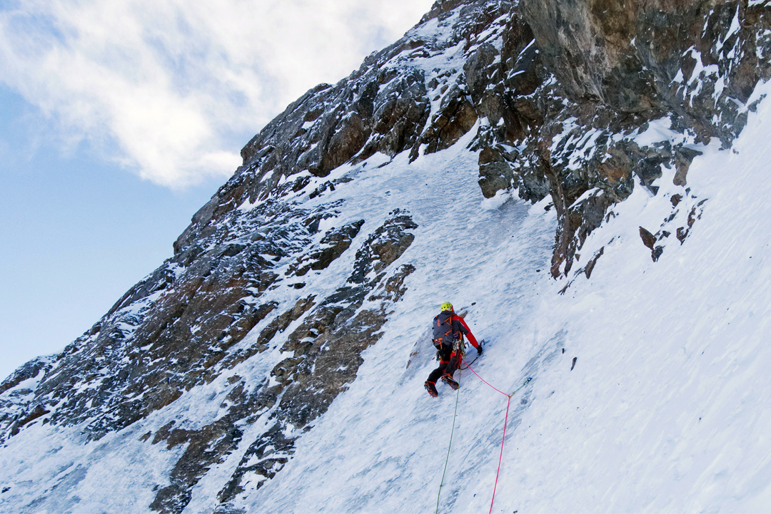 Kirill Belotserkovskiy starting the ice runnels of the upper part of the December 2018 route on the north face of Ordzhonikidze.