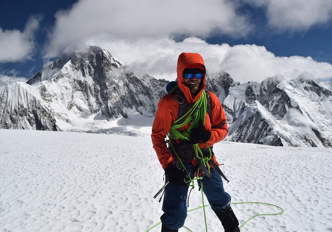 JJ Cieslewicz on the summit of Nyambo Konka (6,114m). Behind and facing the camera is the magnificent south pillar of Minya Konka (7,556m). In the fall of 2018 this pillar was the target of Nick Bullock and Paul Ramsden (U.K.), but appalling weather prevented any attempt.