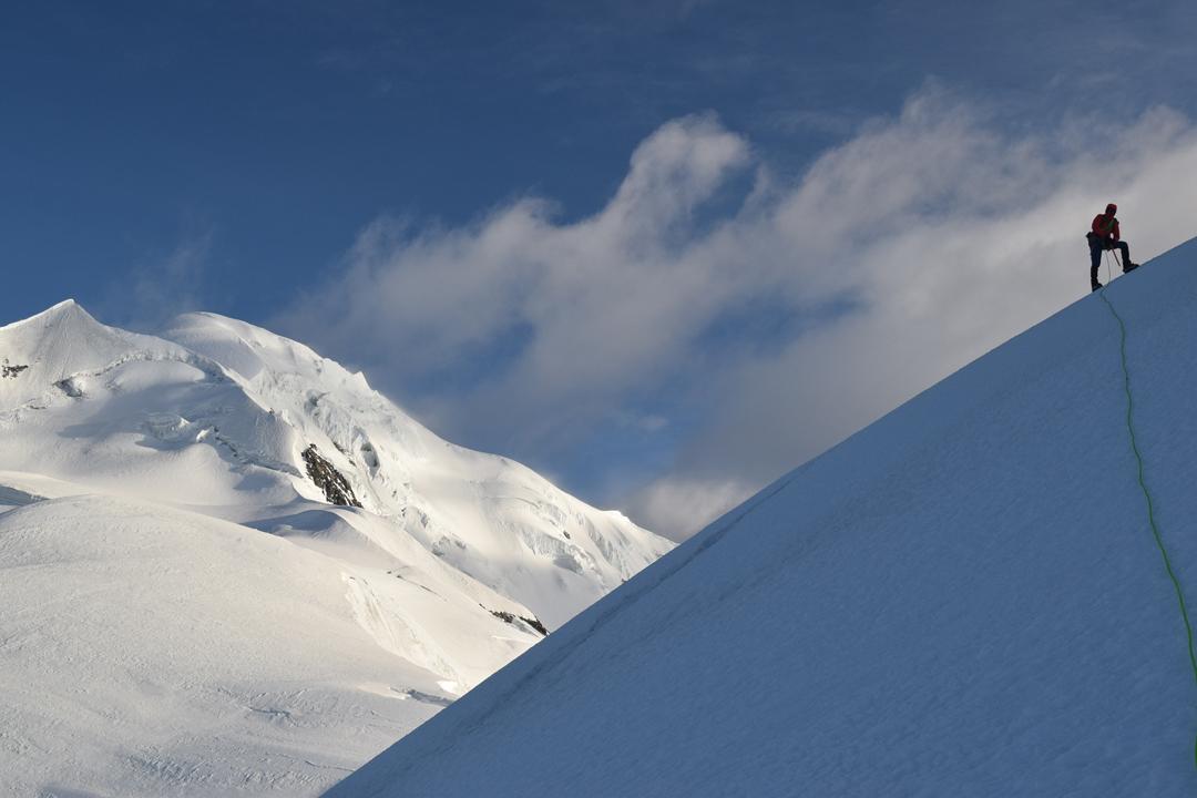 JJ Cieslewicz on the south-southeast ridge of Nyambo Konka, heading for the 6,114m summit.