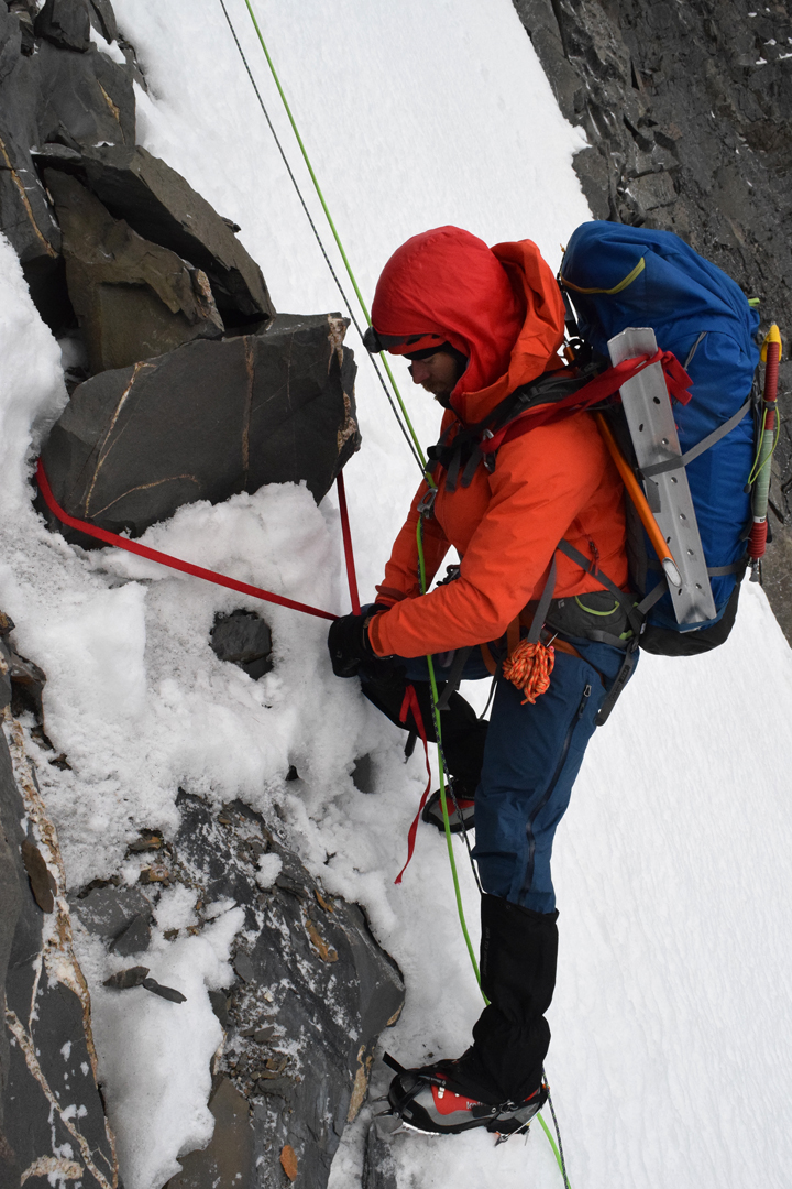 JJ Cieslewicz rappelling a couloir on the northeast face of Nyambo Konka after completing the second ascent of the mountain, by the northeast face and south-southeast ridge.