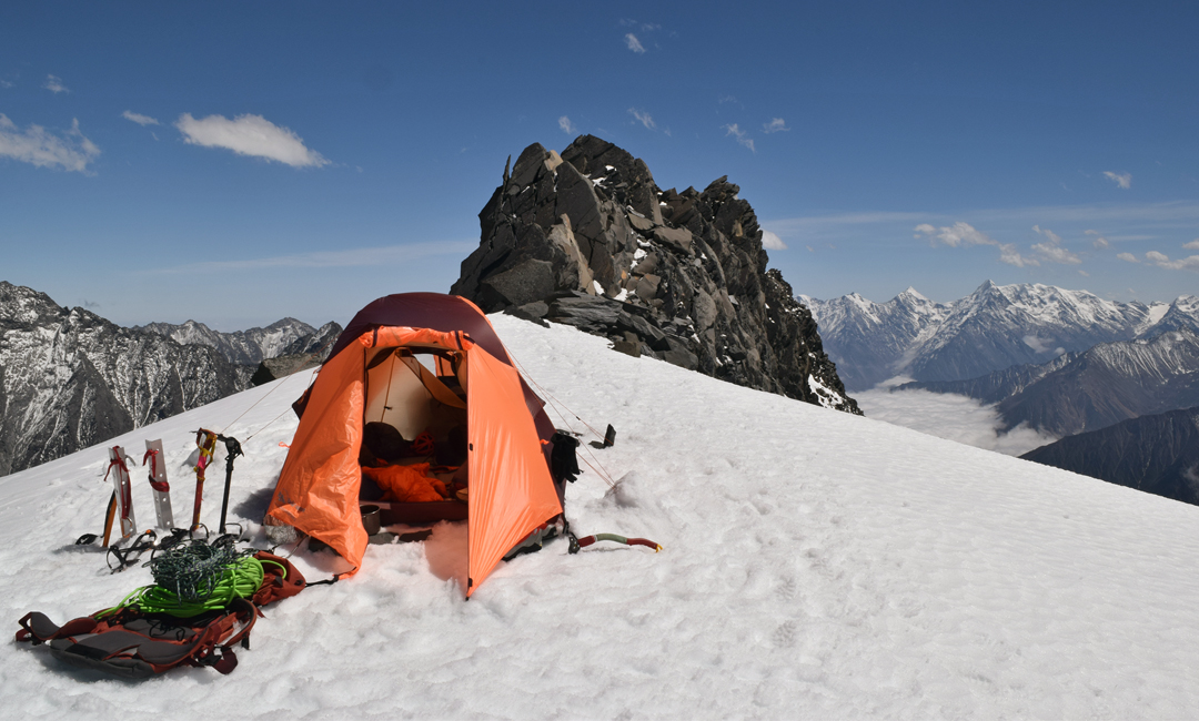 Camp at 5,550m on the south-southeast ridge of Nyambo Konka. The highest pointed peak in the far distance, almost due south, is Ren Zhong Feng, climbed in 2009 by a Danish team (AAJ 2010). The 1979 Chinese Survey recorded a height of 6,079m for this peak, but in 2005 it was revised to 5,731m. The Danish GPS and altimeters recorded 5,820m, while Google Earth is 5,875m.