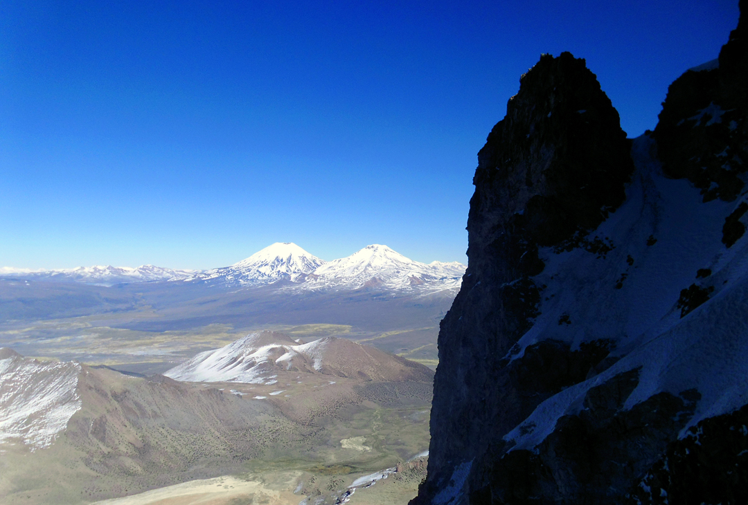 The twin volcanoes of Parinacota (6,348m, left) and Pomerata (Pomerape, 6,222m), seen from the west face of Sajama.