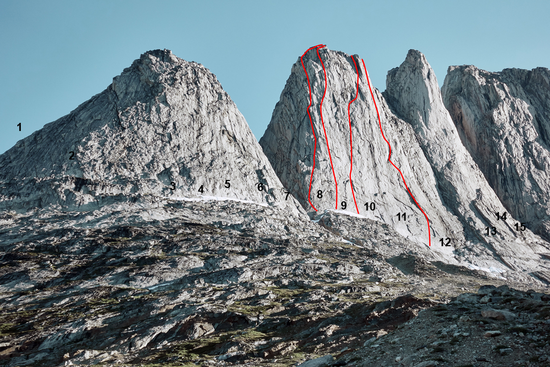 Lower Fox Jaw Cirque, showing the positions of known routes. Route lines are not available for many routes; the lines shown are approximate. (1) Doublemint Direct (III 5.8). (2) Qui nell'Universo (VI). (3) Tooth Fairy (III 5.8). (4) Days of Miracle and Wonder (E2 5c). (5) Long Distance Call (E3 5c). (6) Back Alley Dentistry (HXS, 5.10 X). (7) Southeast Buttress (III 5.9). (8) Stonecircle (7c). (9) El Cavajo dell'angel (7b). (10) Ingirumimusnocte (7b+). (11) Lovin' All the Right Places (5.10 A2+). (12) Le Privilege du Renard (7b). (13) Emozione Polare (VIII). (14) Beers in Paradise (5.10+ A0). (15) Tears in Paradise (5.11 A1). Not marked is Guten Zeiten, Schlechte Zeiten (5.8) in the middle of the south face of Milk Tooth.