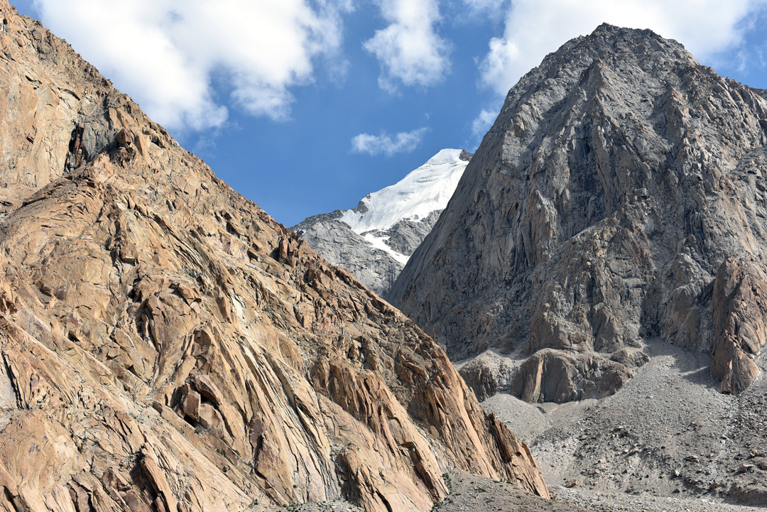 """Extensive untouched granite in the lower Rongdo Valley. In the background, and visible from the shepherds' huts at Doksa, lies the unclimbed peak of Yonchap Kangri (around 6,050m, summit hidden) at 34°24'3.59""""N, 77°52'47.98""""E."""