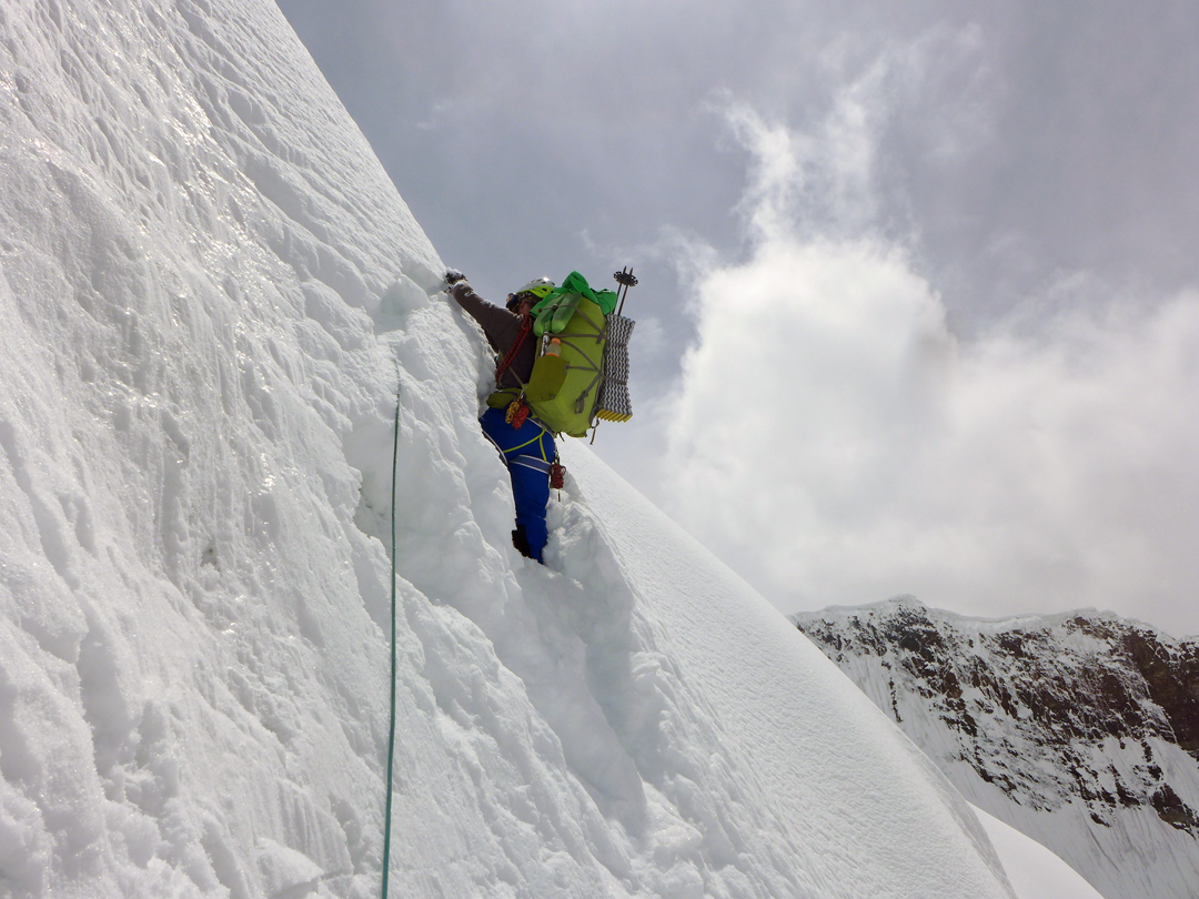 Simon Taffner battling steep, unconsolidated snow at around 5,100m on the approach to Majlina during the Ak-tau traverse.