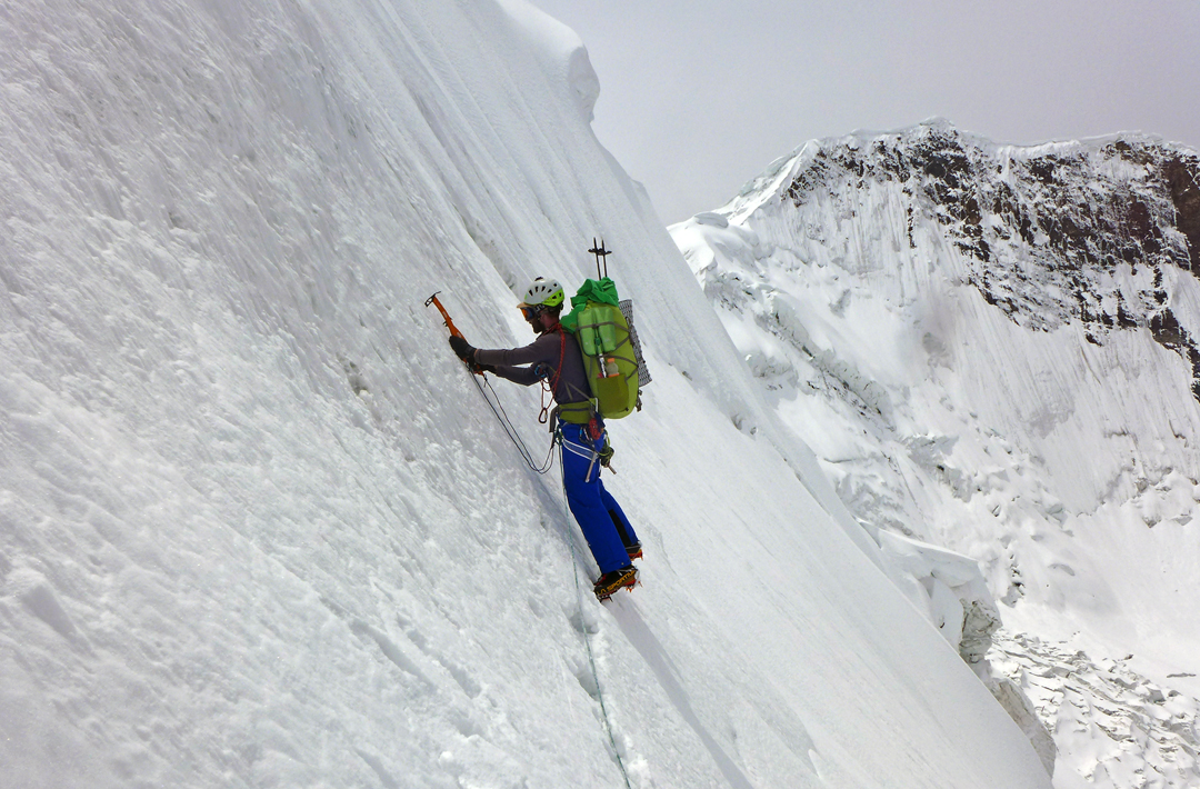 Simon Taffner on a steep snow face at 5,100m during the approach to Majlina.