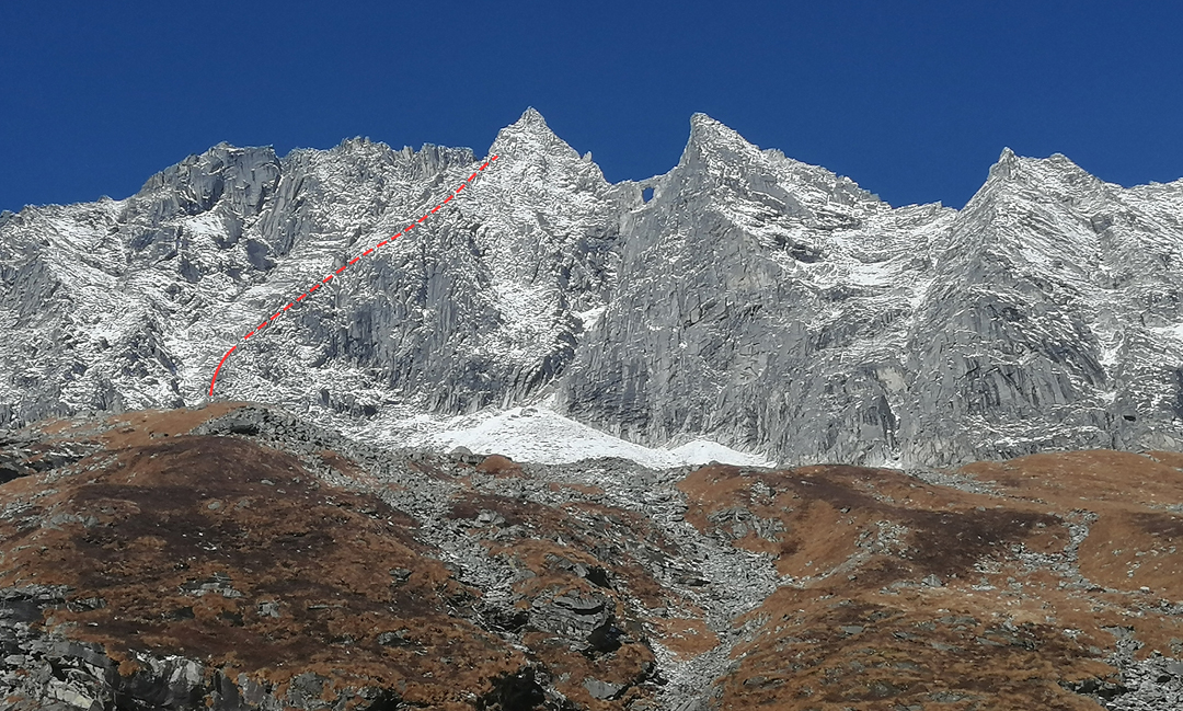 The east side of the Khela Danda with the conspicuous rock arch (the Mugu Eye) visible to the right of the main summit. The attempted route toward Peak 5,467m in 2018 is shown. The previous year, two Germans inspected this area for possible routes but they realized they had too little gear for any serious rock climbing (AAJ 2018).