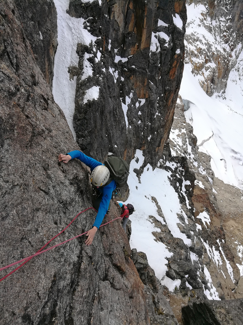 Nearing a delicate traverse at the end of pitch three of Coni's Dream, east face of Charquini.