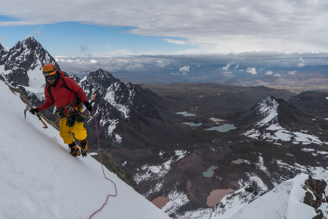 Macario Crispin traversing a snow slope on the west face of Jampa II.