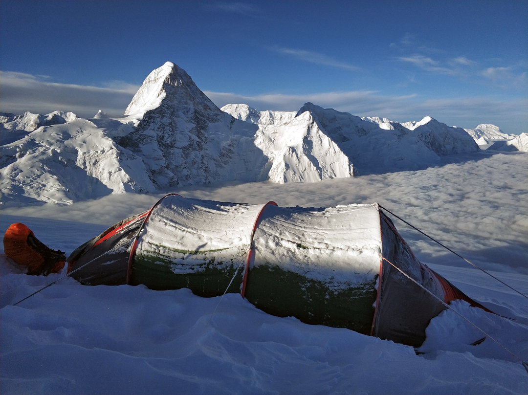 Camp on the summit of Bayancol, with the north face of Khan Tengri (6,995m) prominent behind and the top of Pik Pobeda (7,439m) seen through the high col immediately to the right.