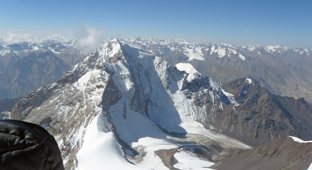 Unclimbed Pik 5,140m seen from the summit of Ushat. The climbers were unable to determine which peak is higher and thus which is the highest in this range. Mountains in the distance are in the Djangart Range.