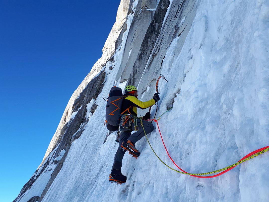 Kirill Belotserkovskiy traversing left below a rock barrier to gain the first bivouac on Baintha Brakk West II.