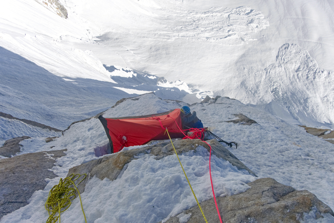 Looking down on the first bivouac at around 5,600m on the north face of Baintha Brakk West II.