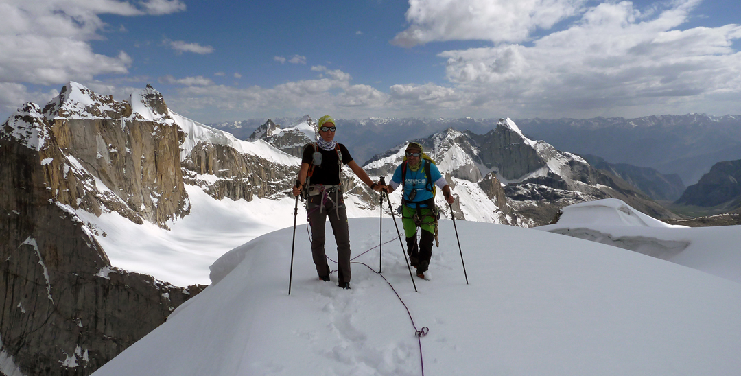 Nancy Paoletto and Massimo Faletti on the summit of Snow Peak, with Kiris Peak behind and to the right.