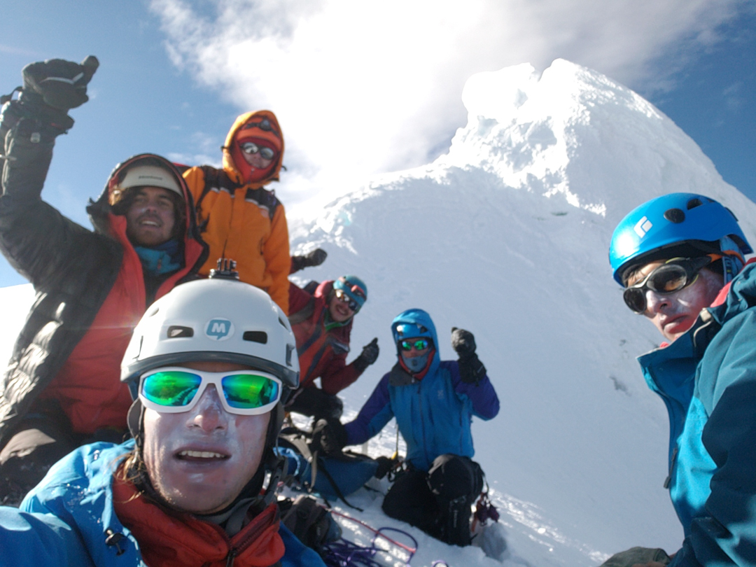 The team poses just below the main summit of Nevado Huantsán.