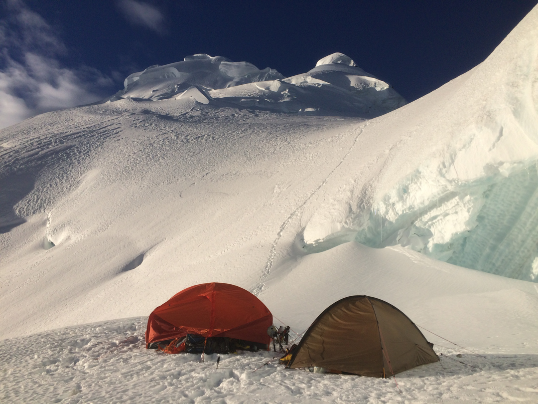 The 2018 team's high camp with the west summit of Nevado Huantsán behind.