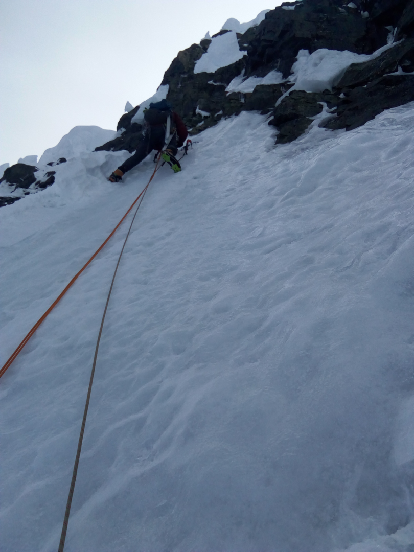 Johannes Suikkanen climbing steep mixed terrain on Nevado Huantsán.