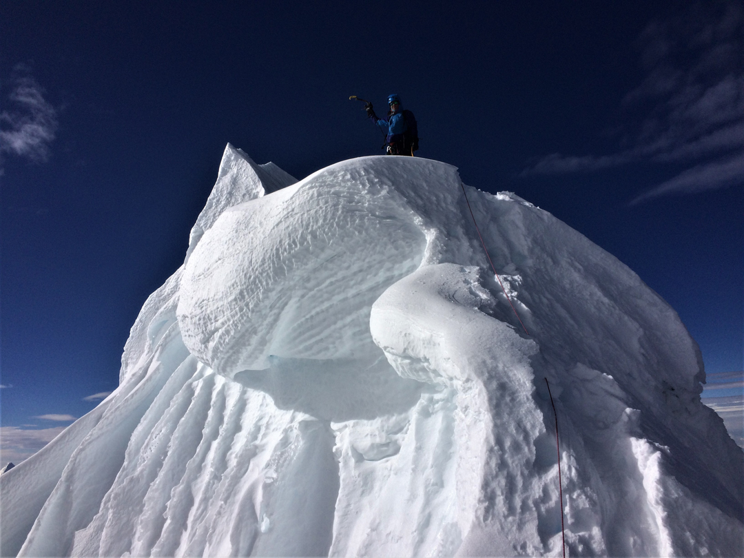 Nathan Heald poses on the final summit cornice of Nevado Huantsán.