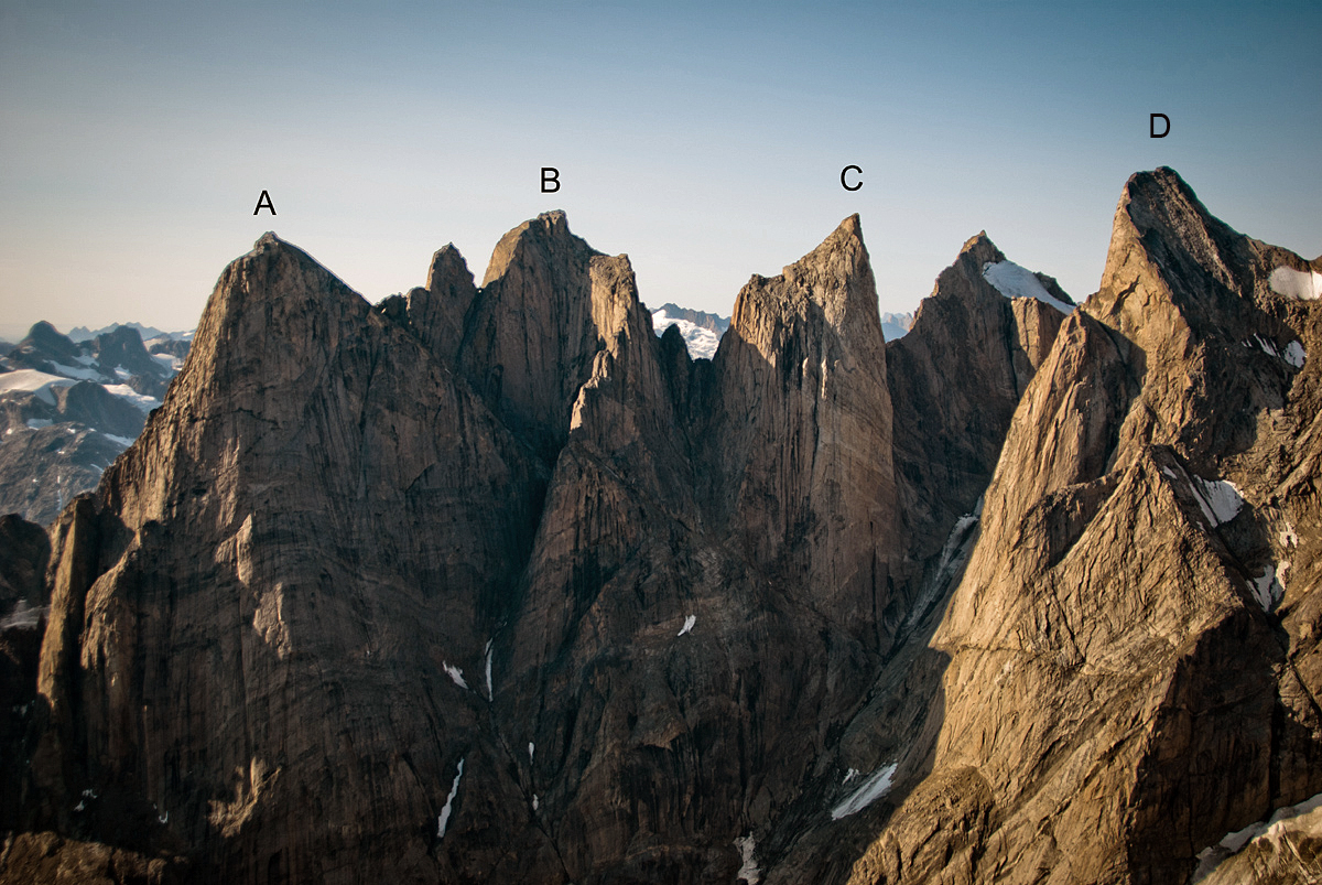 The northern aspect of (A) Ataatap Tower. The 2018 French route climbs the central prow; Built Fjord Tough (2012) is to its left. (B) Hidden Tower. (C) The unclimbed Siren Tower. (D) Aurora Tower. The 2018 French route finished on the northeast ridge, the sun-shadow line facing the camera.
