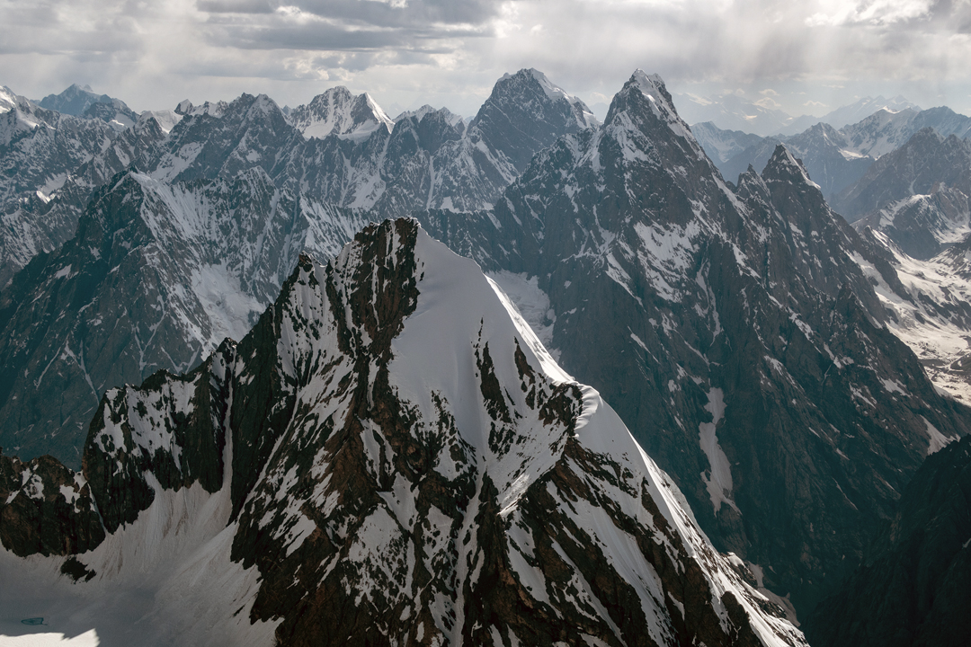 Looking west from Kachqiant at unclimbed Peak 5,900m, which looks like a smaller version of Kachqiant when seen from the north. In the background is the range of peaks explored in 1999 by an International UIAA expedition led by Jean Claude Marmier and another French expedition (AAJ 2000).