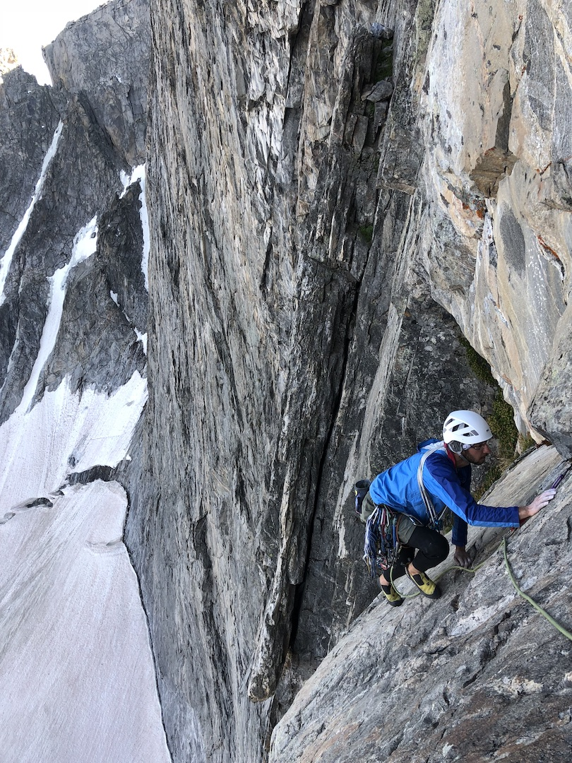 Taimur Ahmad following the final slab of pitch six of In Honor of Crazy Horse (1,200', IV 5.12a) on Wyoming's Cloud Peak.