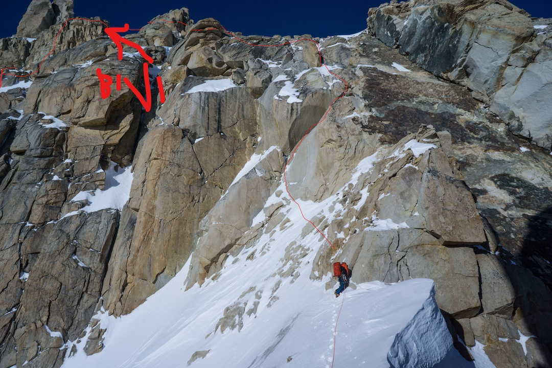 Uisdean Hawthorn leading on the upper section of Fun or Fear (1,200m, M6+ AI6 R 90˚) during the first ascent in April 2018. Portions of the upper route and the team's bivy site are shown.