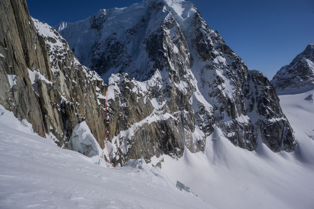 The col just east of the south face couloir on Jezebel (9,620') in the Revelation Mountains. After descending the couloir, Tom Livingstone and Uisdean Hawthorn climbed four pitches up this ridge and descended the other side to return to their skis on the Fish Glacier below the east face.