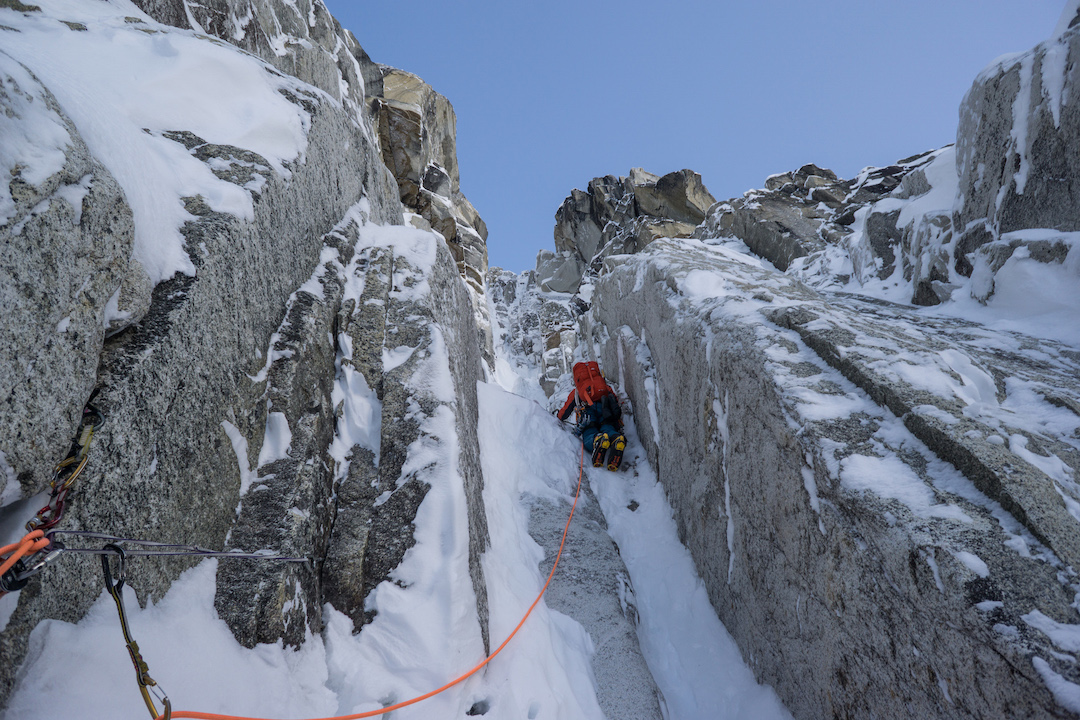 Uisdean Hawthorn leading pitch two of Fun or Fear (1,200m, M6+ AI6 R 90˚) on the east face of Jezebel (9,620') in Alaska's Revelation Mountains. Hawthorn and Tom Livingston climbed this new route over two days in early April 2018 after an attempt on the unclimbed north face of the peak.