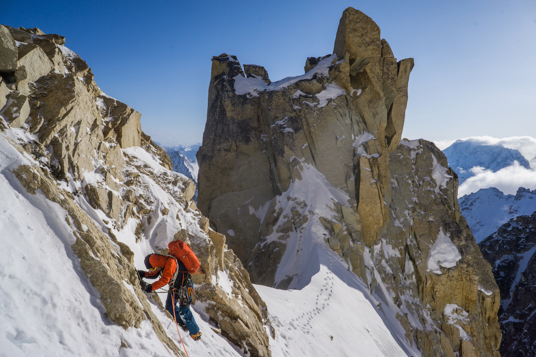 Uisdean Hathorn following along the aesthetic south ridge of Jezebel's east summit (9,450') during the first ascent of Fun or Fear (1,200m, M6+ AI6 R 90˚).