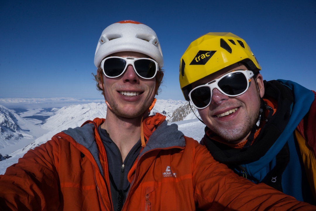 Tom Livingstone (left) and Uisdean Hawthorn on the east summit of Jezebel (9,450') in the Revelation Mountains after making the first ascent of Fun or Fear (1,200m, M6+ AI6 R 90˚) on the mountain's east face.